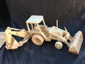 Backhoe tractor roles and operates like the real thing handcrafted out of wood by local artist for Sale in Mesa, AZ