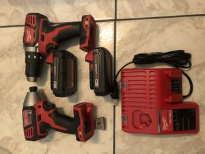 New Milwaukee 18 V drill set comes with two batteries one charger one impact gun and a drill this is not a hammer drill and it's not a brushless set$ for Sale in Lauderhill, FL