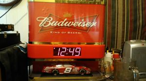 Budweiser clock light and #8 car in a 18'' by18'' case for Sale in Brandon, MS