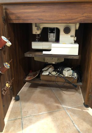 Kenmore sewing machine in a wood furniture piece for Sale in Queens, NY