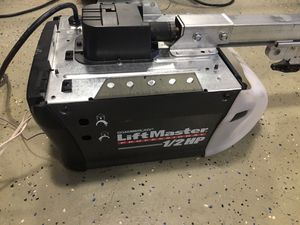 Good used complete LiftMaster Screwdrive garage door opener with 2 remotes and outside keypad for Sale in Peoria, AZ
