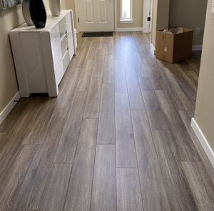 Water resistant 12mm laminate flooring w/pad 1. 99/sf for Sale in Vancouver, WA