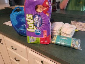 2 pks Luvs size 1 diapers plus 15 newborn diapers and accessories for Sale in Clearwater, FL