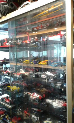 2 glass display full of Racing collection cars for Sale in Houston, TX