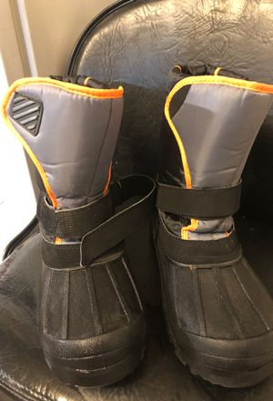Insulated boots size 6 for boys are girls an snow for Sale in Sterling, KS