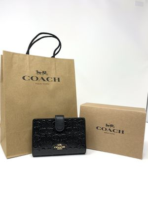 Coach - Medium Corner Zip in Signature Debossed Print (Black) for Sale in Fontana, CA