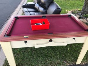 Mini pool table and on the other side air hockey for Sale in Minneapolis, MN