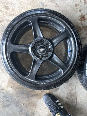 "17"" 4x100 bolt pattern painted black 3 of 4 tires good one has slow leak for Sale in Gap, PA"