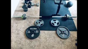 OLYMPIC WEIGHTS AND BARBELL for Sale in Buckeye, AZ