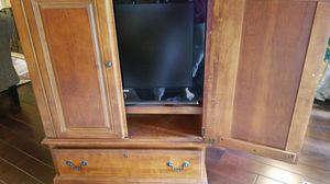 Samsung 31 inch tv mounted on swivel arm in solid wood cabinet for Sale in Seattle, WA