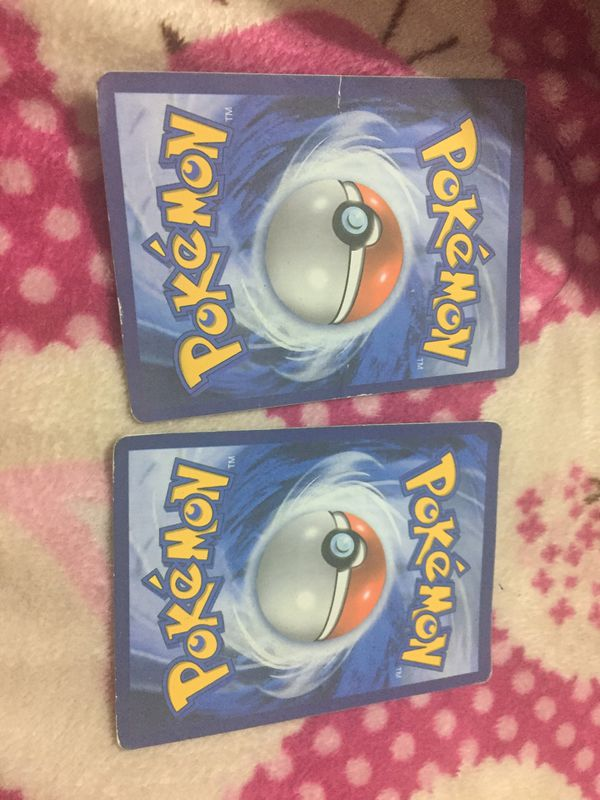 Pokémon mystery card they're both good cards and pick one or two left is 1 right is 2