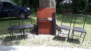 Dining room table dark wood with black with four black chairs for Sale in Spring Hill, FL