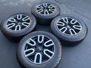 "(4) 20"" GMC Sierra rims and 275/60R20 BridgeStone A/T tires for Sale in Santa Ana, CA"