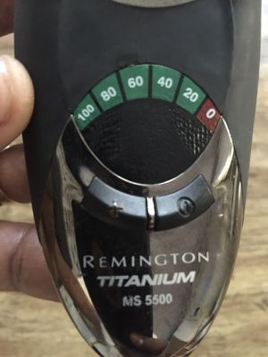 Remington titanium electric shaver with cleaning station and solution for Sale in Durham, NC