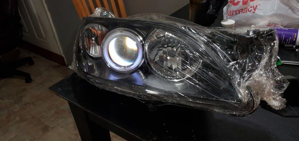 Brand new never used in original packaging. Mazda 3 CCFL HALO BLACK HOUSING PROJECTOR HEADLIGHTS