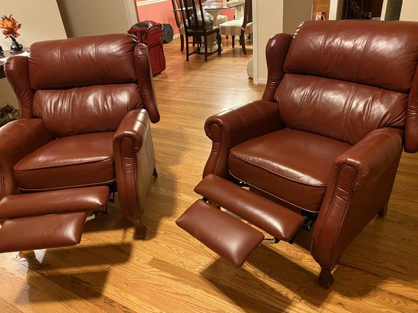 Two Dark red leather recliners
