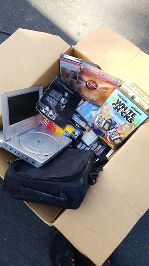 DVDs and portable DVD player for Sale in Puyallup, WA