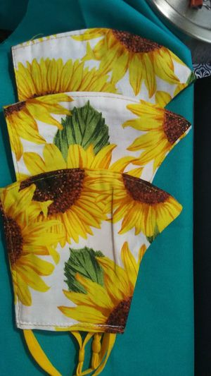 Bright sunflower print face masks with NEW adjustable elastic for ease on the ears. for Sale in West Columbia, SC