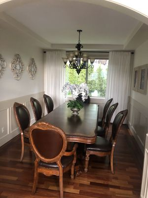 Gorgeous Formal Dining room table and eight very comfortable leather chairs for Sale in Happy Valley, OR