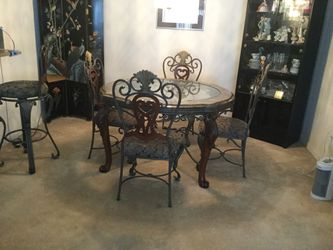 Dining room table and four chairs with marble and glass top sculptured legs for Sale in Chesterfield,  MI