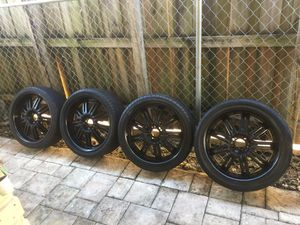 "Set universal rims black with tires 20"" Good Condition for Sale in Miami, FL"