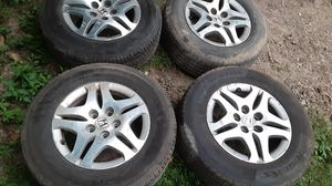 235 65 16 tires on 2006 honda odyssey wheels. Good set of 4 rims and tires for Sale in Bloomington, IN
