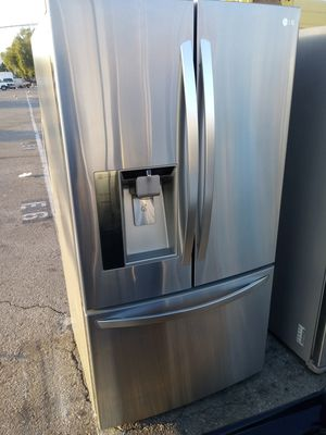 LG French door refrigerator/ 3 month warranty and free local delivery for Sale in San Fernando, CA