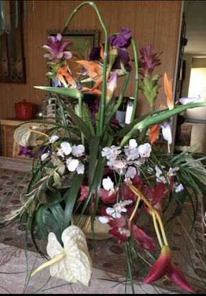 Various kind of exotic flowers arrangement in a clay pot for Sale in Wheeling, IL