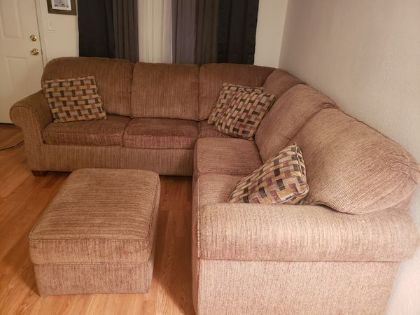 Sectional couch with ottoman nothing wrong w it jus normal uses but in fair condition. pk up only can not deliver