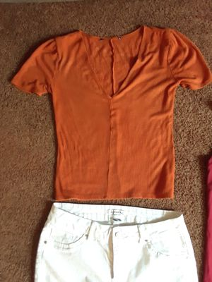 2 size large crop shirts and size 7 white skinny jeans take all 12 $ for Sale in Riverside, CA