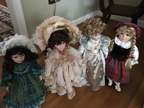 Set of 11 dolls with stands- excellent condition