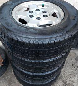 ORIGINAL STOCK Rim's Chevy Silverado/Tahoe/Suburban/GMC/YUCON ALL MATCHING 245/75/16 All Matching GENERAL GRABBER HT tires for Sale in San Bernardino,  CA