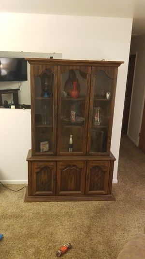 Curio cabinet with interior light for Sale in Martinsburg, WV