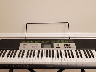 NEW CASIO LK-135 DIGITAL PIANO WITH ACCESSORIES for Sale in Duncan,  SC