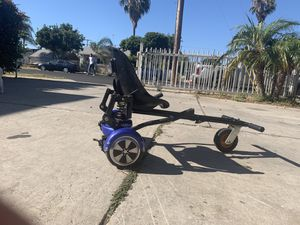 Hoverboard with the charger and the cart seat for Sale in National City, CA