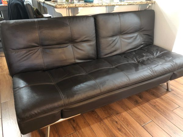 Leather couch (Brown Futon) with usb and power ports.