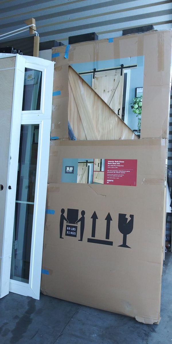 ReliaBilt Pine Unfinished Z-Frame Wood Pine Barn Door