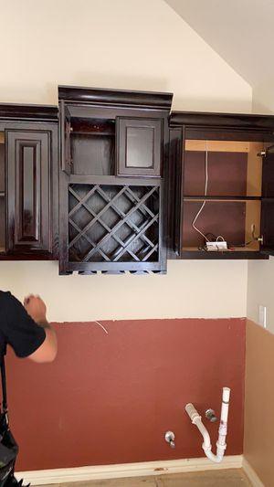 Cabinets kitchen wine cellar holder for Sale in Carrollton, TX
