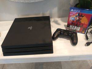 PlayStation Pro with remote control and game for Sale in Miami, FL