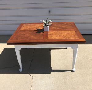 HARDWOOD DINING TABLE WITH INTEGRATED EXTENSION LEAVES for Sale in Redlands, CA
