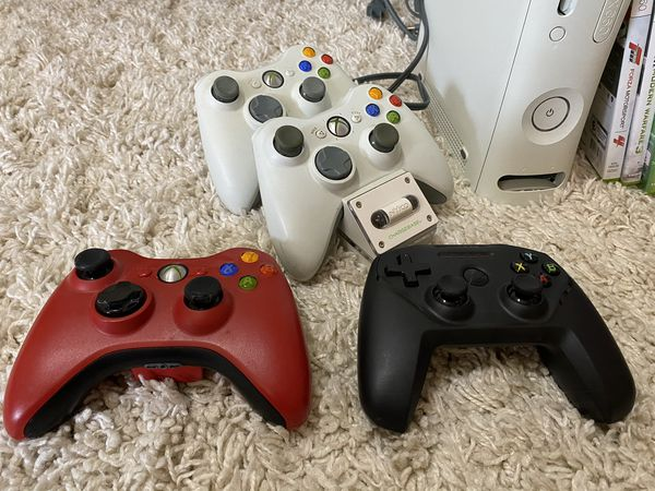 XBOX 360 with games, wireless network adaptor, controllers, and chargers
