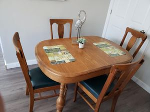 Real solid wood table with chairs for Sale in Clearwater, FL