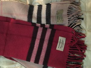 Two brand name designer scarfs long thick never wore Burberry scarves with original tag seamed onto each wear as a set or one asking 400 for both or for Sale in Nashville, TN
