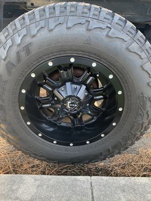 TIS 17 inch black rims falken wild peaks 33 inch tires excellent condition Chevy 5x5 lug pattern fit keeps and Tacoma's5 lugs for Sale in Fontana, CA