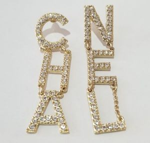 Cz diamond dangle earrings gold for Sale in Austin, TX