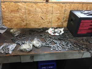 Over 25 chainsaw chains blades mostly are 16 and 18 inch for Sale in Livonia, MI