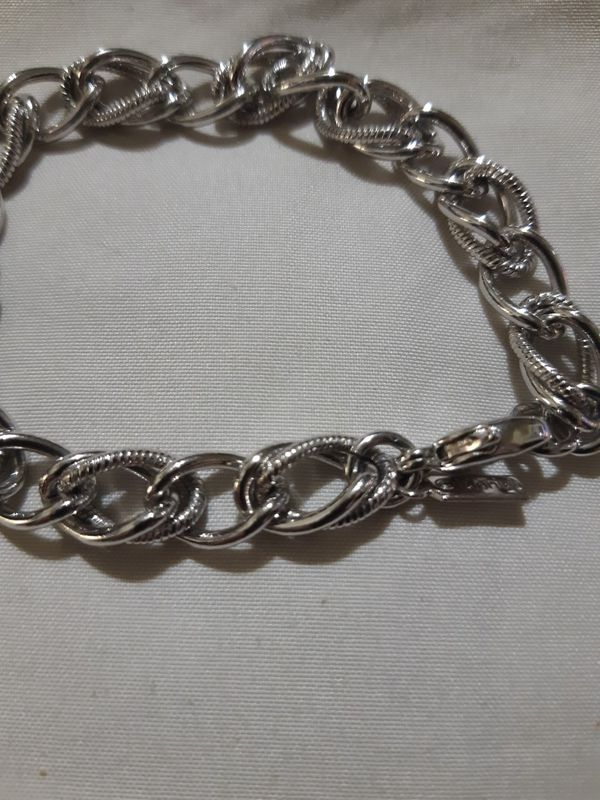 vintage Monet silver figure 8 charm bracelet.