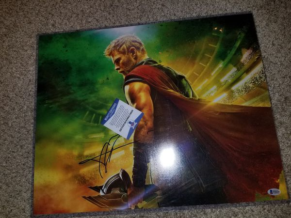 Thor 16x20 Signed by Chris Hemsworth. Beckett Certified