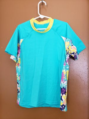 Girls Patagonia Flower Swim Top Size: Tag says size 10, but smaller like 7/8, stretchy for Sale in El Paso, TX