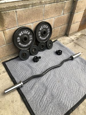 Olympic weights 33s,2.5s and Curl Bar new for Sale in Los Angeles, CA